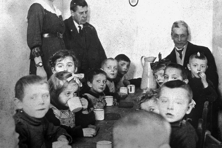 Children eating at table.
