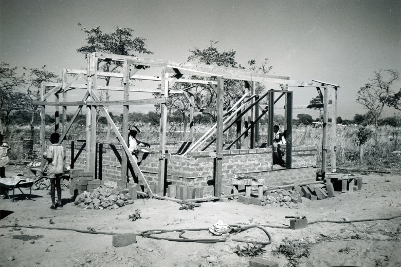Man works on constructing a brick building.