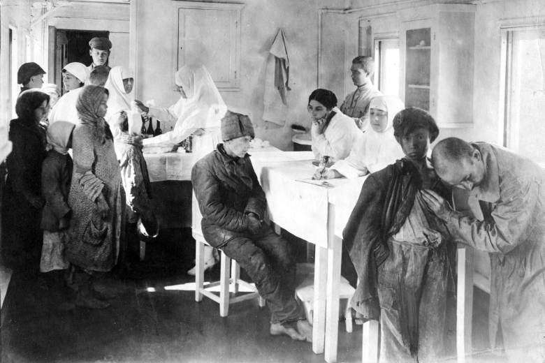 Room with doctors, nurses and patients.