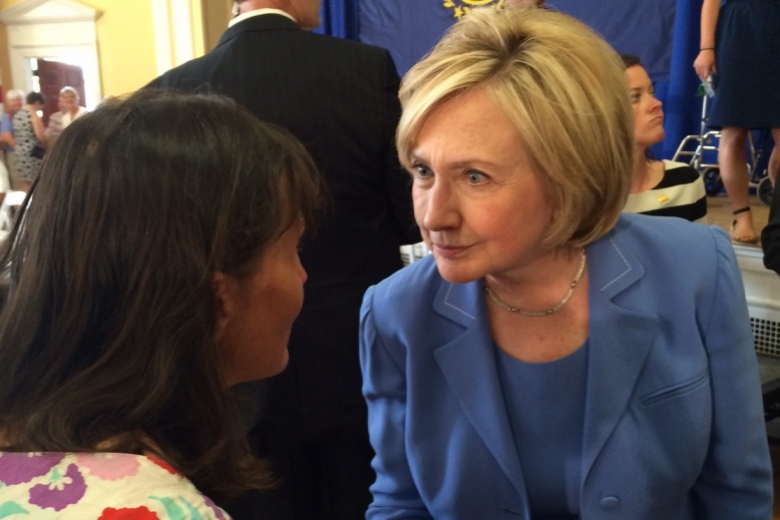 Young woman talking with Hillary Clinton.
