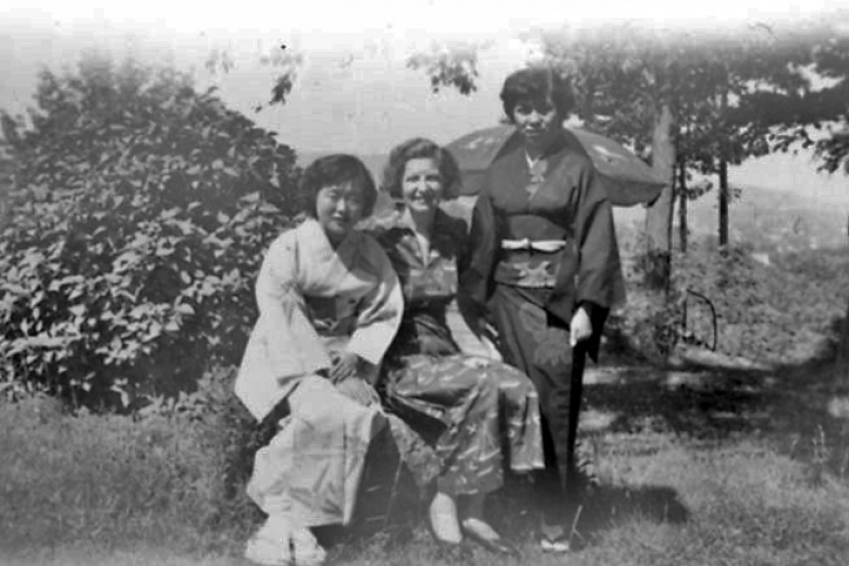 Three women in traditional Japanese clothing sitting together