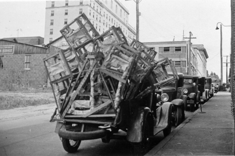 Car filled with chairs and other furniture