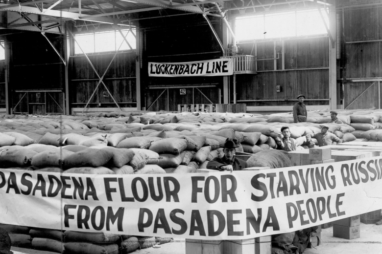 "Many sacks of flour with sign: ""Pasadena flour for starving Russians."""