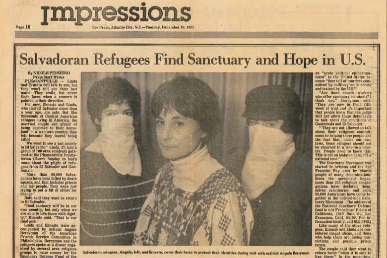 Photo of an image in a newspaper showing three women, two of which wearing bandanas that cover their nose and mouth.
