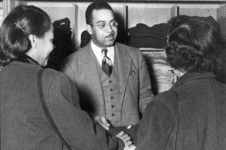 Man speaks with two women.