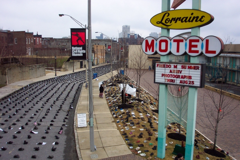 Lines of boots fill the street outside the Lorraine Motel.